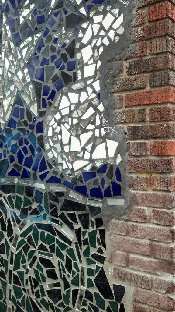 where the mosaic meets the brick. so lovely.